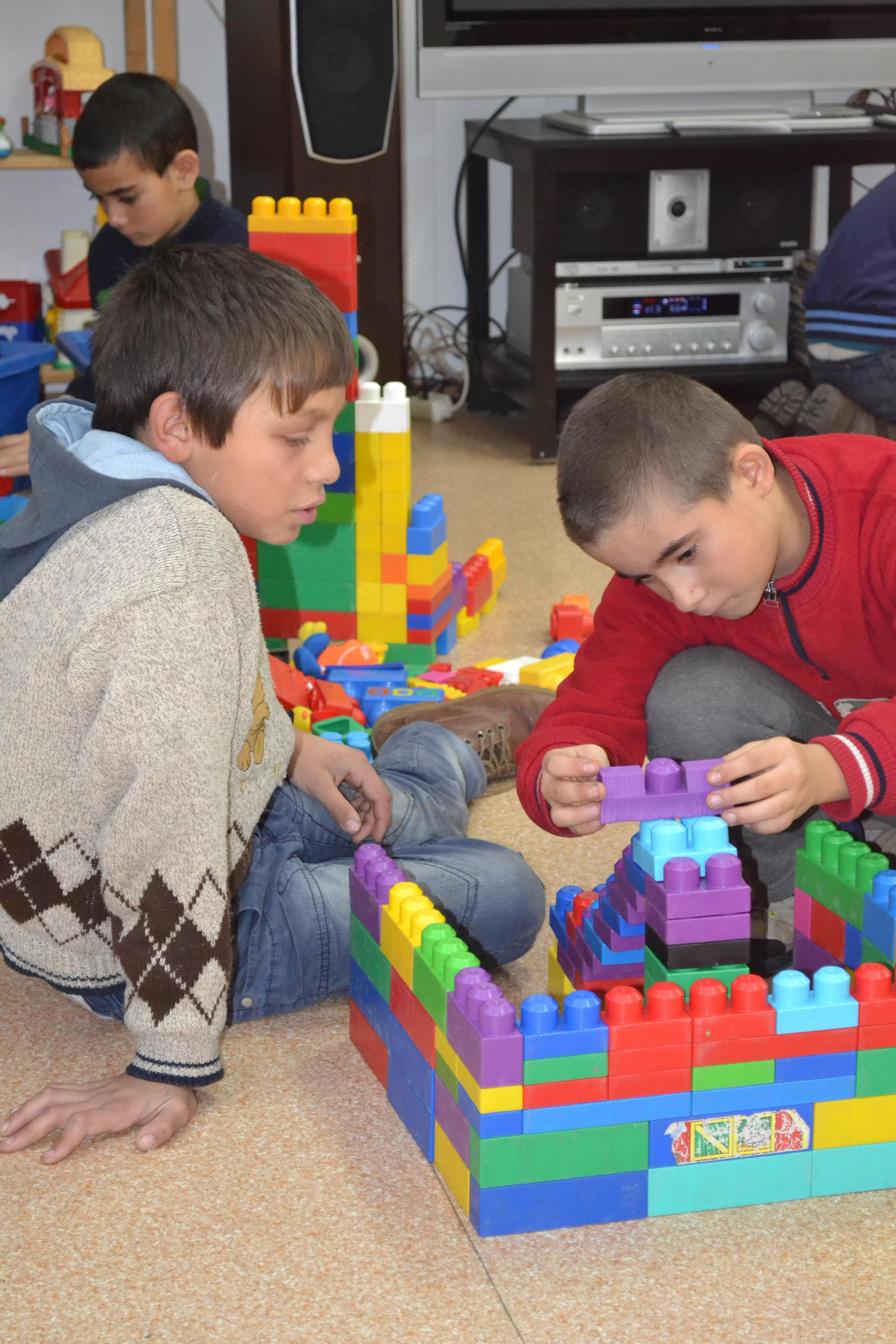 Children play with toys during their break at a Childcare placement in Romania